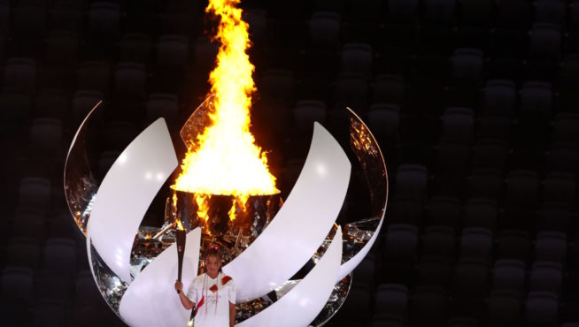TOKYO, JAPAN - JULY 23, 2021; Tennis player Naomi Osaka lighted the Olympic torch during the Opening Ceremony of the Tokyo 2020 Olympic Games at Olympic Stadium on July 23, 2021 in Tokyo, Japan. Picture is for press use; photo by ATP Hiro YAKUSHI